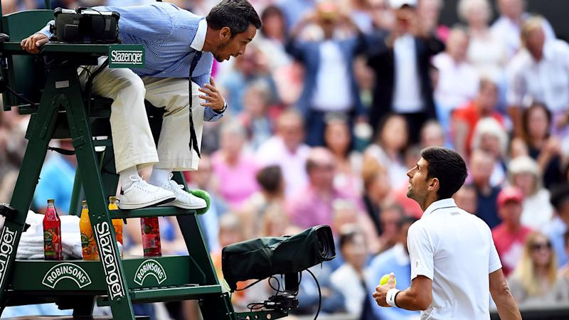 Novak Djokovic speaks to the umpire about the call in the fifth set of the final. (Photo by Victoria Jones/PA Images via Getty Images)