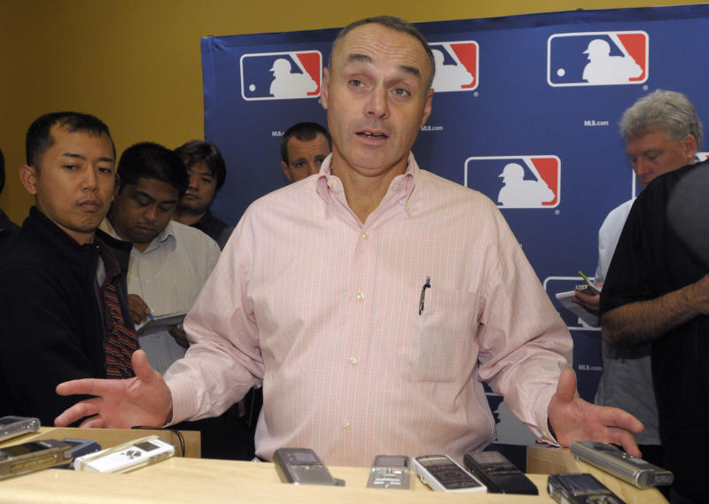 Rob Manfred, Major League Baseball executive vice president for labor relations, talks to reporters during the meeting of baseball's general managers in Lake Buena Vista, Fla., Tuesday, Nov. 16, 2010. (AP Photo/Phelan M. Ebenhack)
