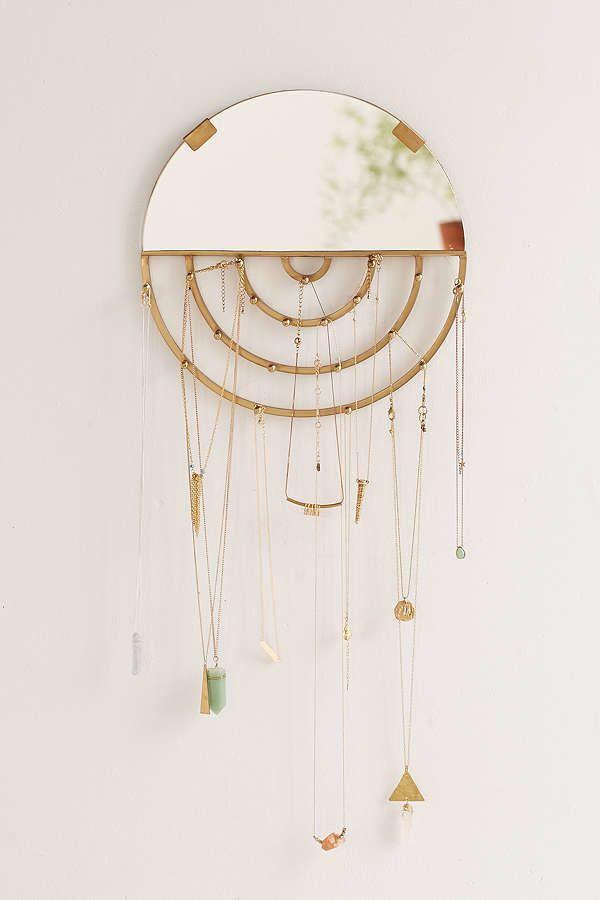 "<i>Buy it from <a href=""https://www.urbanoutfitters.com/shop/aimee-jewelry-storage-hanging-mirror?category=gift-ideas-for-women&color=027&reviewPage=3"" target=""_blank"">Urban Outfitters</a> for $29.</i>"