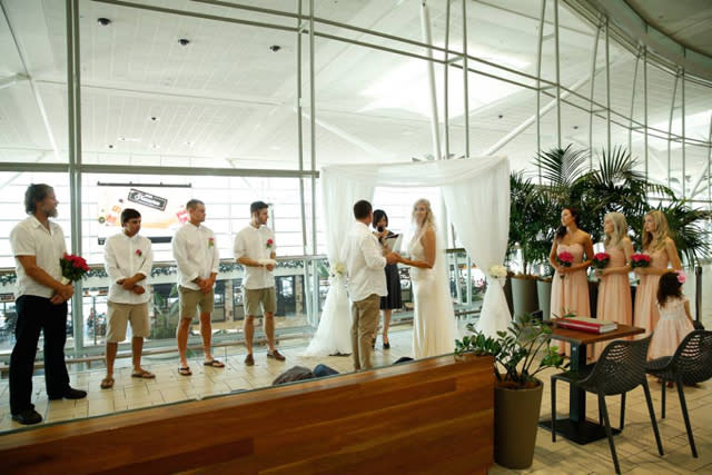 Couple get married at Brisbane Airport amid passport chaos