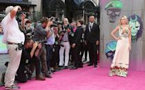 <p>Margot Robbie dutifully poses for the paparazzi at the photocall. </p>