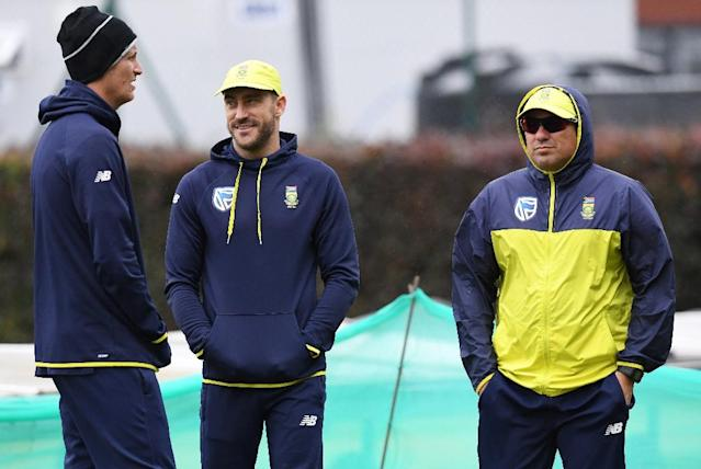 South Africa's Chris Morris (L), captain Faf du Plessis (C) and coach Russell Domingo attend a nets practice session at Old Trafford cricket ground in Manchester, England (AFP Photo/PAUL ELLIS)