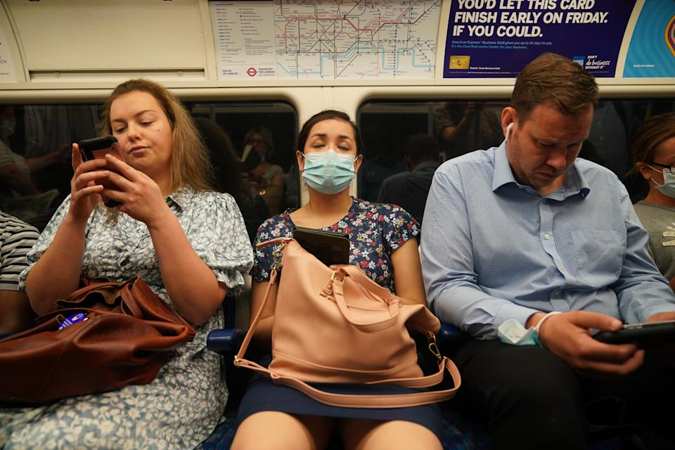 Commuters, some not wearing facemasks, on a Jubilee Line tube train to Westminster at 0822 in London after the final legal Coronavirus restrictions were lifted in England. Picture date: Monday July 19, 2021.