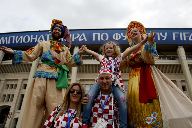 Croatia fans pose for a picture before the semifinal match between Croatia and England at the 2018 soccer World Cup in the Luzhniki Stadium in Moscow, Russia, Wednesday, July 11, 2018. (AP Photo/Rebecca Blackwell)
