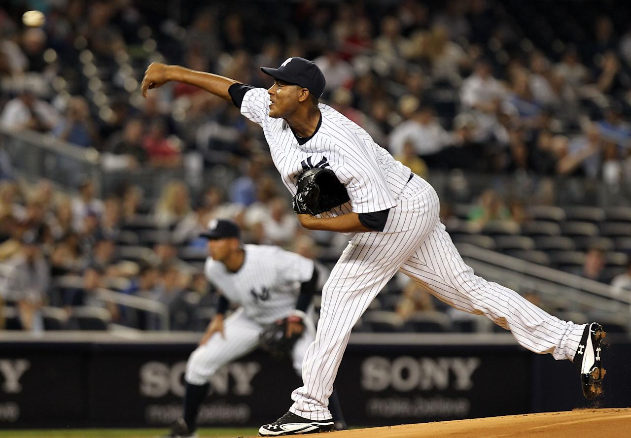 NEW YORK, NY - APRIL 15:  Ivan Nova of the New York Yankees pitches against the Los Angeles Angels of Anaheim at Yankee Stadium on April 15, 2012 in the Bronx borough of New York City. In honor of Jackie Robinson Day, all players across Major League Baseball will wear number 42(Photo by Nick Laham/Getty Images)