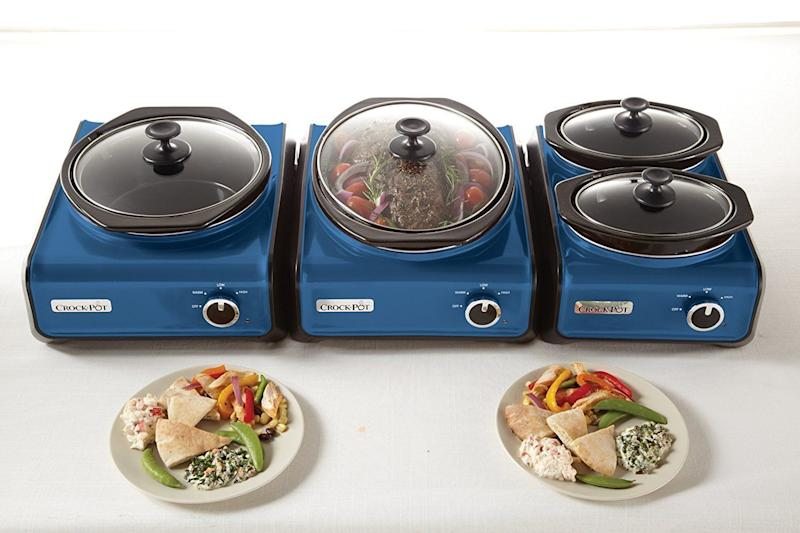 """<a href=""""https://www.amazon.com/Crock-Pot-SCCPMD2-CH-Connectable-Entertaining-Metallic/dp/B00D45N4KQ?th=1"""" target=""""_blank"""">Crock-Pot's connectable entertaining systems</a> can cook an entire Thanksgiving meal."""