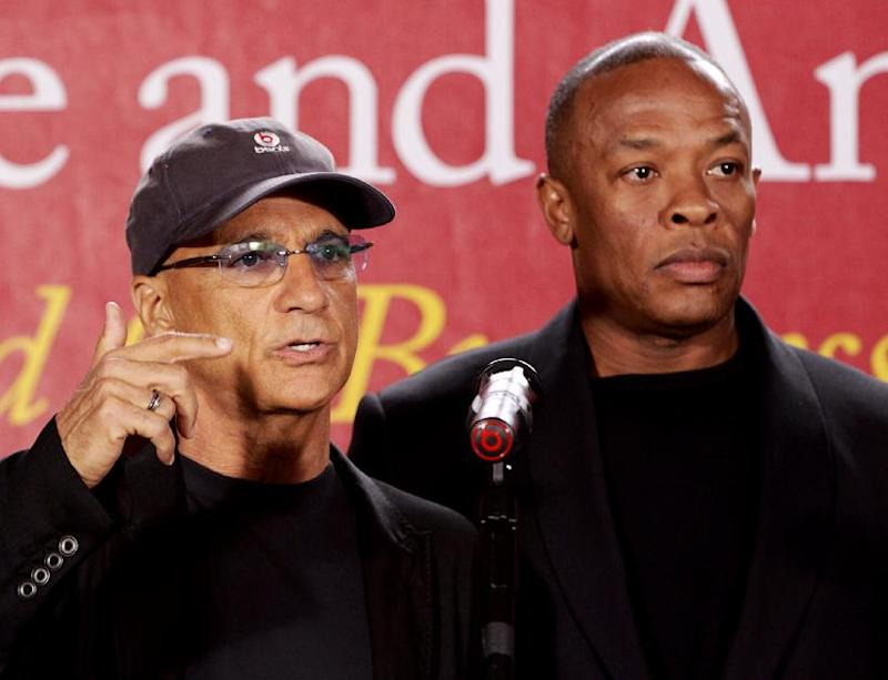 """Jimmy Iovine, the co-founder of Interscope Records, left, stands with partner hip-hop mogul Dr. Dre, as they announce a $70 million dollar donation to create the new """"Jimmy Iovine and Andre Young Academy for Arts and Technology and Business Innovation,"""" Wednesday, May 15, 2013, at the University of Southern California, during a news conference at in Santa Monica, Calif.  (AP Photo/Damian Dovarganes)"""