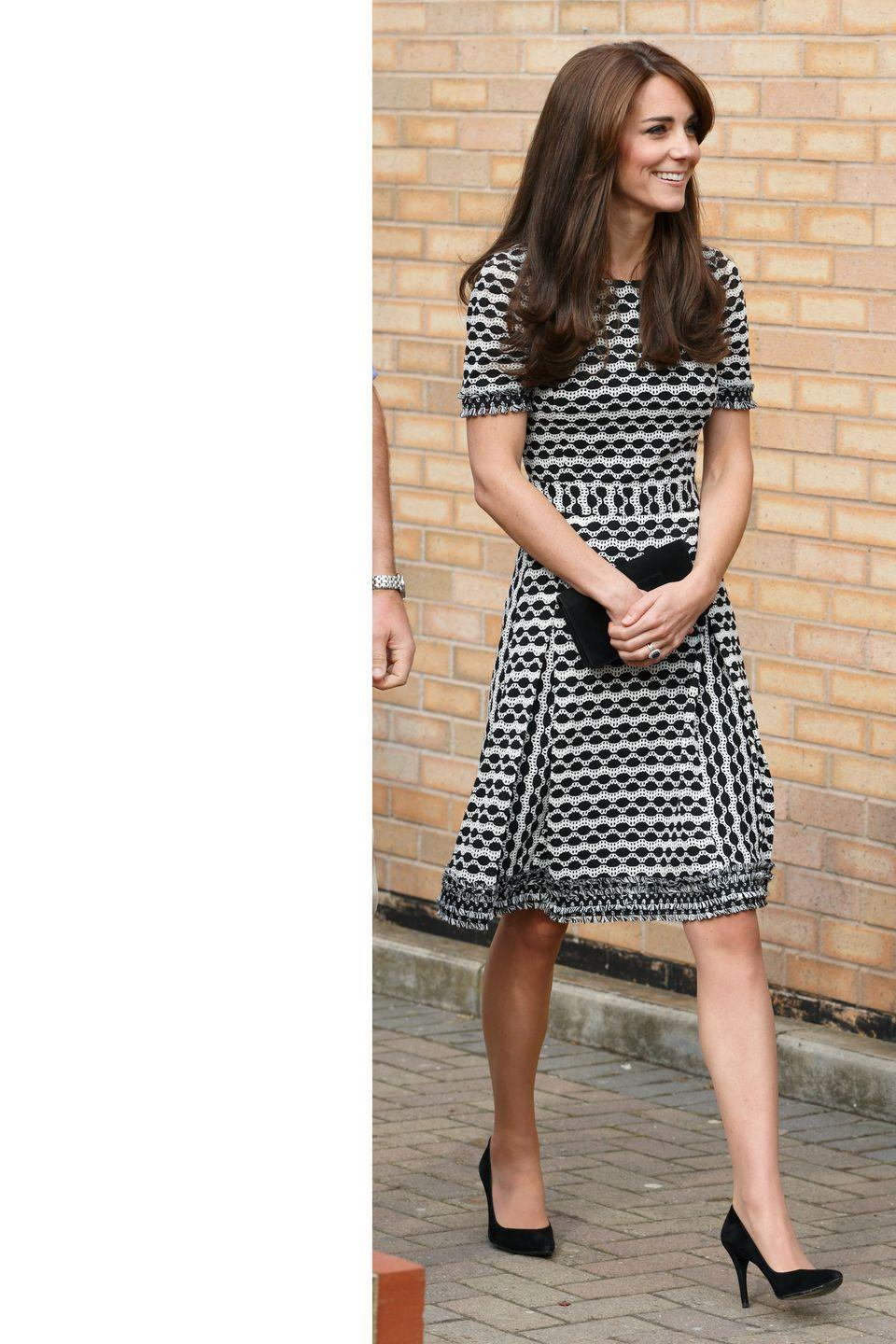 <p>The Duchess makes a public appearance for World Mental Health Day wearing a Tory Burch dress with simple black pumps and a clutch. </p>