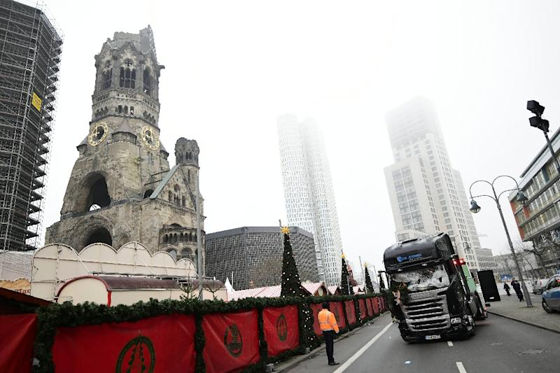 The crash happened in Berline at a square at the end of the Kurfuerstendamm boulevard in the shadow of the Kaiser Wilhelm Memorial Church whose damage in a World War II bombing raid has been preserved as a reminder of the horrors of war (AFP Photo/Tobias SCHWARZ)