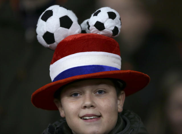 A soccer fan wears a hat in the colors of the Dutch flag during the Euro 2020 group C qualifying soccer match between The Netherlands and Estonia at the Johan Cruyff ArenA in Amsterdam, Netherlands, Tuesday, Nov. 19, 2019. (AP Photo/Peter Dejong)