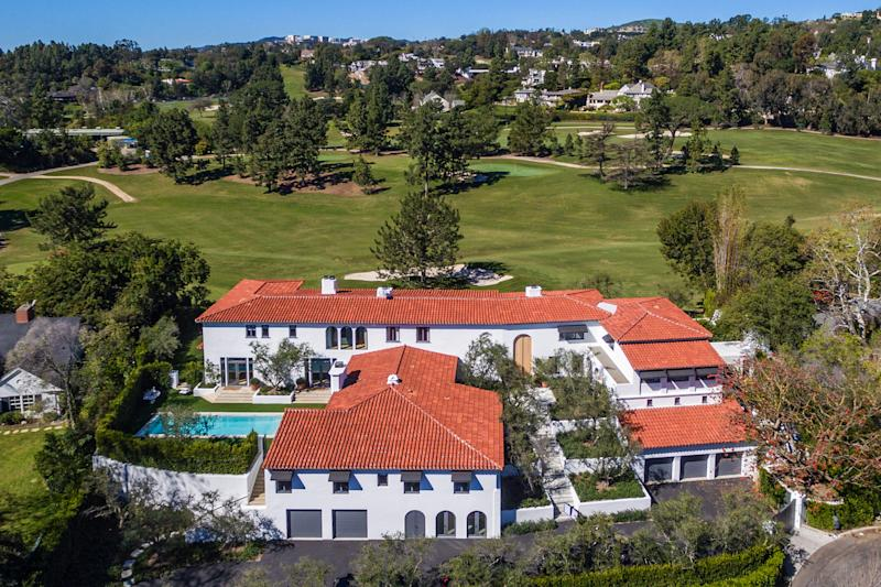 Lori Loughlin and Mossimo Giannulli are selling their Beverly Hills home for $28 million — down from the $35 million they asked before the college admissions scandal. (Photo: Splash News)