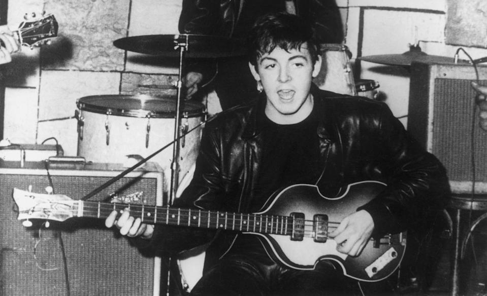 Paul McCartney on stage at the Cavern nightclub in Liverpool during the early days of British beat group The Beatles. (Photo by Keystone/Getty Images)