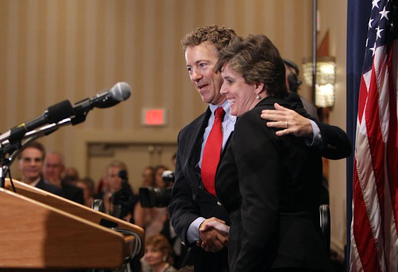 U.S. Sen. Rand Paul, R-Ky., hugs New Hampshire State GOP chairwoman Jennifer Horn as he is introduced at the New Hampshire Republican State Committee Liberty Dinner, Monday, May 20, 2013 in Concord , N.H. (AP Photo/Jim Cole)