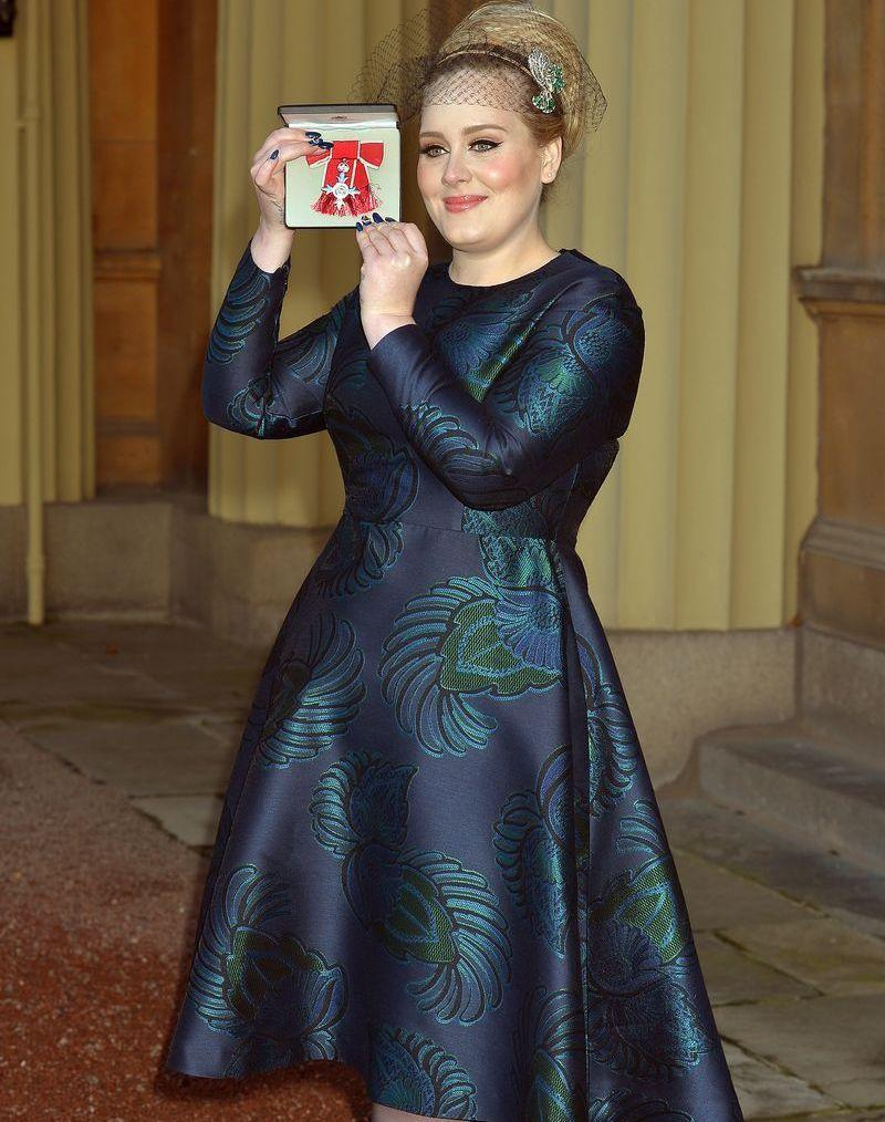 <p>Adele opted for an embroidered navy A-line dress and a statement headpiece for her visit to receive an OBE from the Queen. And just like that, we're not bored by blue dresses anymore.</p>