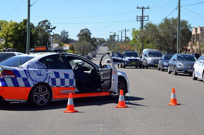 Police cordon off a street in the Guildford area of Sydney on September 18, 2014 following Australia's largest ever counter-terrorism raids (AFP Photo/Saeed Khan)