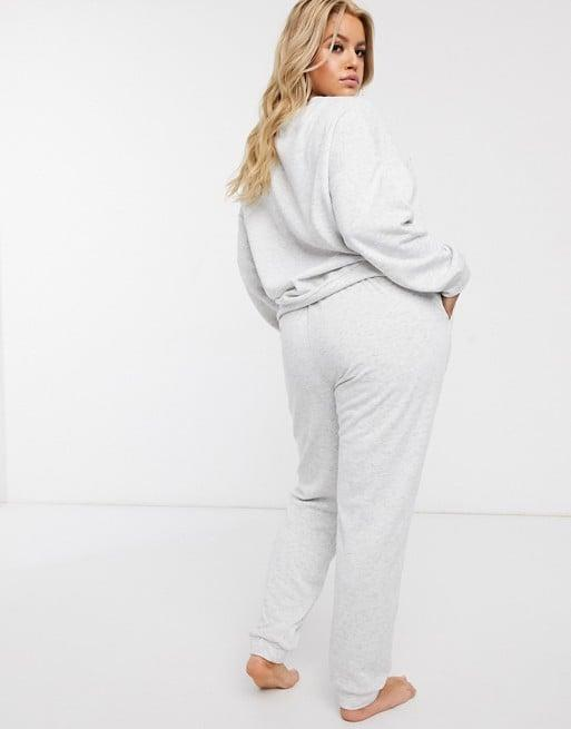 "<p>Stay cozy in this <a href=""https://www.popsugar.com/buy/ASOS-Design-Curve-Lounge-Sweat-amp-Jogger-Set-560896?p_name=ASOS%20Design%20Curve%20Lounge%20Sweat%20%26amp%3B%20Jogger%20Set&retailer=asos.com&pid=560896&price=42&evar1=fab%3Aus&evar9=47346603&evar98=https%3A%2F%2Fwww.popsugar.com%2Ffashion%2Fphoto-gallery%2F47346603%2Fimage%2F47346604%2FASOS-Design-Curve-Lounge-Sweat-Jogger-Set&list1=shopping%2Ccurve%2Cloungewear%2Ccurve%20fashion&prop13=api&pdata=1"" rel=""nofollow"" data-shoppable-link=""1"" target=""_blank"" class=""ga-track"" data-ga-category=""Related"" data-ga-label=""https://www.asos.com/us/asos-curve/asos-design-curve-lounge-sweat-jogger-set/prd/14014035?clr=light-gray&amp;colourWayId=16584698&amp;SearchQuery=&amp;cid=9577"" data-ga-action=""In-Line Links"">ASOS Design Curve Lounge Sweat &amp; Jogger Set</a> ($42).</p>"