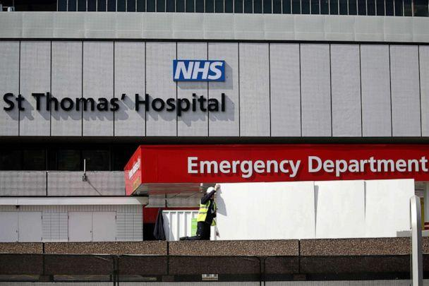 PHOTO: A staff member places screens to shield ambulances at the emergency department of St Thomas' Hospital in central London on April 7, 2020, where U.K. Prime Minister Boris Johnson is in intensive care with symptoms of novel coronavirus infection. (Isabel Infantes/AFP via Getty Images)