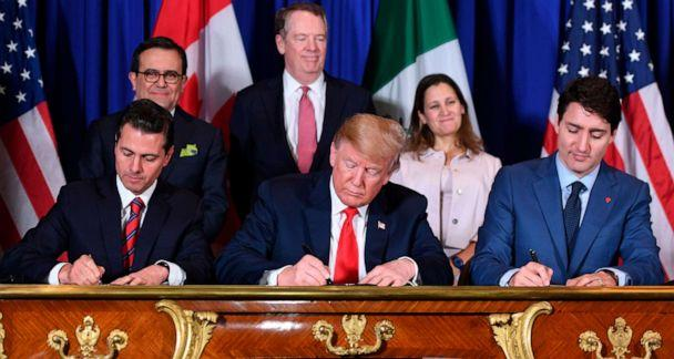 PHOTO: Mexico's President Enrique Pena Nieto, left, President Donald Trump, center, and Canadian Prime Minister Justin Trudeau, sign a new free trade agreement in Buenos Aires on Nov, 30, 2018, on the sidelines of the G20 Leaders' Summit. (Saul Loeb/AFP via Getty Images)