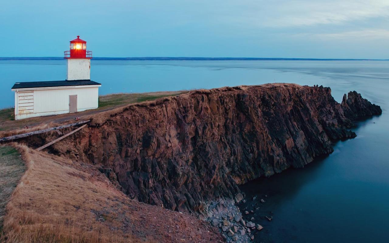 "<p>Visitors flock to the serene <a href=""http://www.capedor.ca/index2.html"">Cape d'Or</a> headland in the Canadian province of <a href=""https://www.novascotia.com/"">Nova Scotia</a> for its scenic panoramas and natural wonders. Built in 1874, the <a href=""http://www.capedor.ca/index2.html"">Lighthouse on Cape d'Or</a> hovers above the Bay of Fundy, set against a dense forest of towering pines and offering unobstructed vistas of the Minas Basin. Although somewhat challenging to reach, it's known for providing a remote yet stunning retreat for its overnight visitors. But if you're looking for a lavish lighthouse escape, this probably won't fit the bill. A pair of lighthouse keepers' cottages have been transformed into an inn with <a href=""http://www.capedor.ca/20252.html"">quaint but basic accommodations</a>. The seasonal operation runs from May through November, but leave your credit cards at home ― this is a cash-only establishment.</p>"