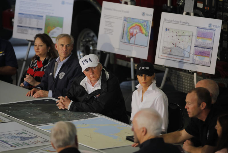 The president and first lady receive a briefing on Tropical Storm Harvey relief efforts with Texas Gov. Greg Abbott in Corpus Christi. (Carlos Barria / Reuters)