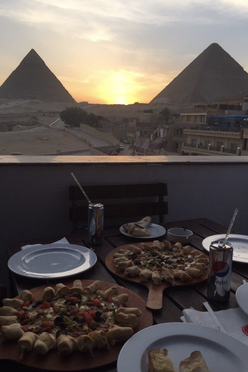 """<p>This Pizza Hut definitely reigns supreme for having the best view. The location sits right in Giza and features a rooftop view of <a href=""""https://www.redbookmag.com/life/g32303304/facts-about-pyramids/"""" rel=""""nofollow noopener"""" target=""""_blank"""" data-ylk=""""slk:the Great Pyramids"""" class=""""link rapid-noclick-resp"""">the Great Pyramids</a>. Yeah, NBD.</p>"""