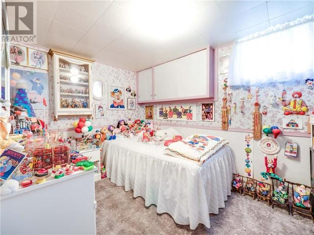 <p>The second bedroom hosts the bulk of the themed clowns, like Loonette and Ronald McDonald. (Zoocasa) </p>
