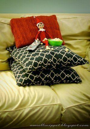 "<p>Set up your elf with some pillows (so she can see the TV) and a popcorn snack. Then, pop a favourite holiday movie in the DVD player.</p> <p>Source: <a href=""http://indulgy.ccio.co/b6/Z4/65/275986283385607975saKAwIsUc.jpg"" target=""_blank"">Indulgy</a></p>"