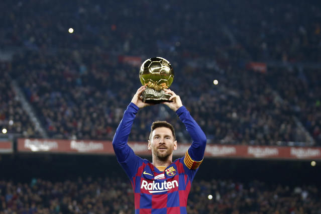 Barcelona's Lionel Messi shows the supporters his sixth Golden Ball for the best player of the year that he was awarded earlier in the week, before a Spanish La Liga soccer match between Barcelona and Mallorca at Camp Nou stadium in Barcelona, Spain, Saturday, Dec. 7, 2019. (AP Photo/Joan Monfort)