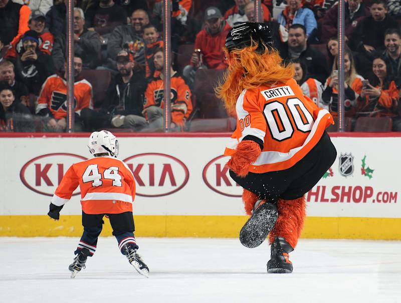 PHILADELPHIA, PA - NOVEMBER 17: Gritty, the mascot of the Philadelphia Flyers interacts with a member of the mites on ice during the second period intermission against the Tampa Bay Lightning on November 17, 2018 at the Wells Fargo Center in Philadelphia, Pennsylvania. (Photo by Len Redkoles/NHLI via Getty Images)