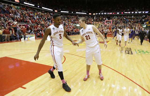 Iowa State forward Melvin Ejim, left, reacts with teammate Matt Thomas (21) after an NCAA college basketball game against Kansas State, Saturday, Jan. 25, 2014, in Ames, Iowa. Ejim scored 20 points as Iowa State won 81-75. (AP Photo/Charlie Neibergall)