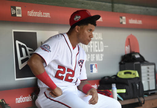 Washington Nationals' Juan Soto looks from the dugout during a baseball game against the Los Angeles Dodgers, Sunday, May 20, 2018, in Washington. (AP Photo/Nick Wass)