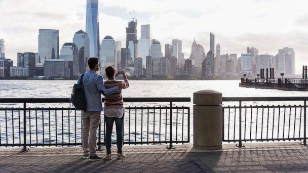 PHOTO: A couple stands looking at Manhattan. (Getty Images/Westend61)