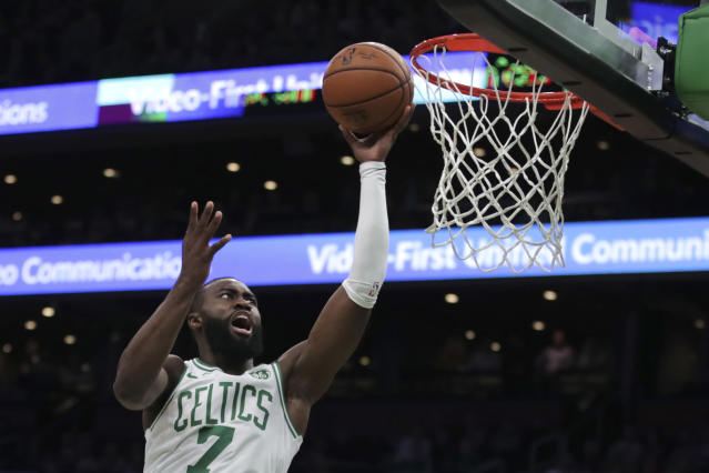 Boston Celtics guard Jaylen Brown drives to the basket against the Detroit Pistons during the first half of an NBA basketball game in Boston, Wednesday, Jan. 15, 2020. (AP Photo/Charles Krupa)
