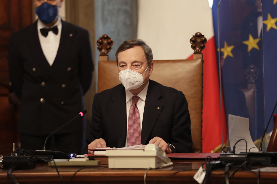 New Italian Premier Mario Draghi presides over his first cabinet of ministers reunion after the swearing-in ceremony, at Chigi Palace Premier's office, in Rome, Saturday, Feb. 13, 2021. (AP Photo/Andrew Medichini)