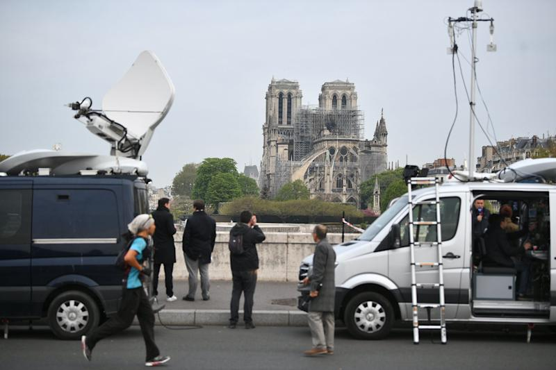 Media crews by the Notre Dame Cathedral in Paris following a fire which destroyed much of the building on Monday evening.