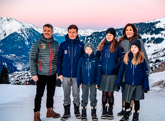 princess Mary Prince Frederik and their kids wearing coats posing on the Swiss Alps