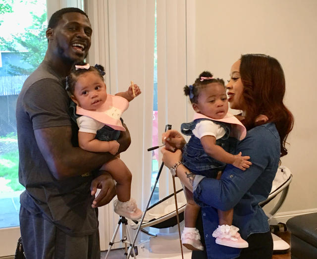 In this Thursday, June 14, 2018, photo, New York Jets cornerback Morris Claiborne, left, holds twin daughter MaLiah while wife Jennifer holds twin daughter MaKaila at their home in Whippany, N.J. Last summer, Claiborne was trying to settle in with his new team, but his mind was on his newborn twins, one of whom was born underweight. (AP Photo/Dennis Waszak Jr.)