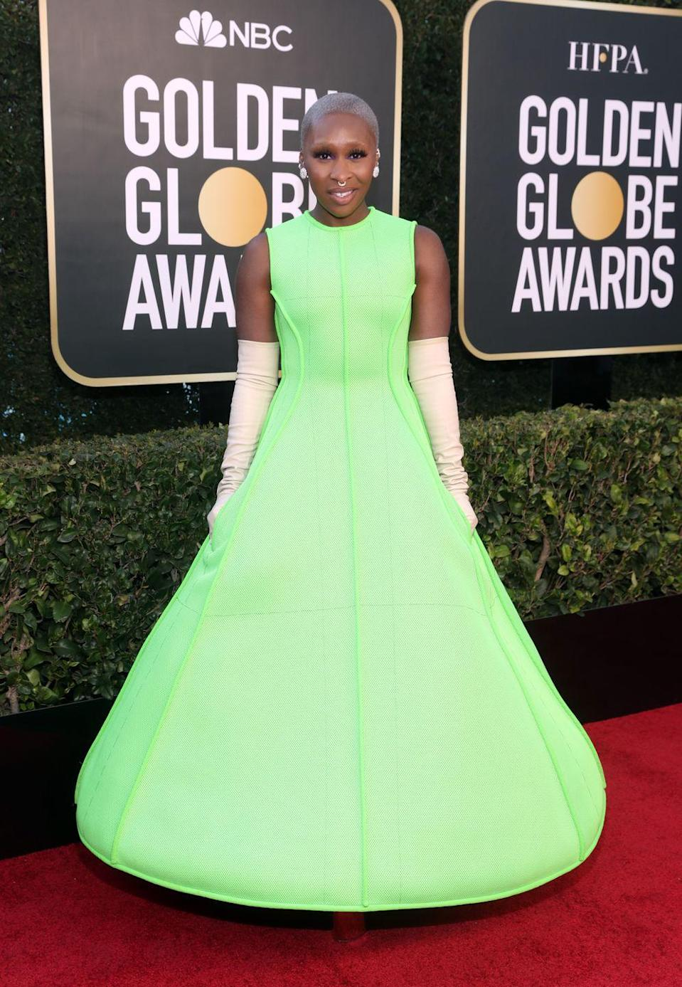 <p><strong>What: </strong>Valentino Couture, Wempe earrings, and Maria Tash jewelry</p><p><strong>Why: </strong>Not everyone can pull off neon green and elbow length gloves, but not everyone is Cynthia Ervivo. The stylish actress isn't afraid to take risks, and reportedly let Valentino be her guide for the evening, to very fun results. </p>