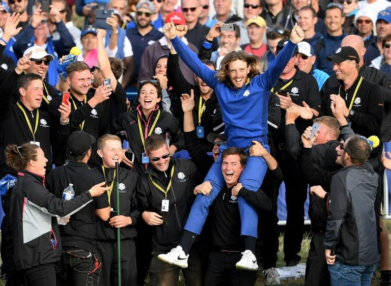 Tommy Fleetwood joins fans to celebrate winning the Ryder Cup in 2018. An event this year without spectators would be unthinkable say top players such as Rory McIlroy