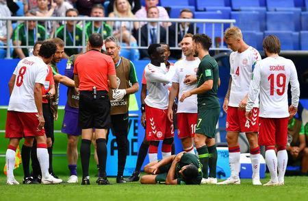 Soccer Football - World Cup - Group C - Denmark vs Australia - Samara Arena, Samara, Russia - June 21, 2018 Australia's Andrew Nabbout is on the floor after sustaining an injury as Denmark's Christian Eriksen looks on REUTERS/Dylan Martinez