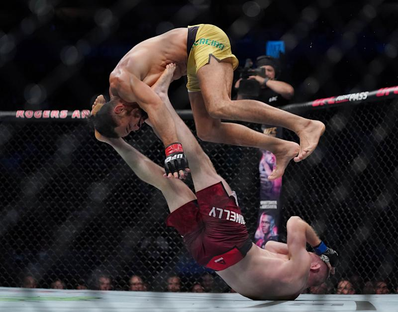 Sep 14, 2019; Vancouver, BC, Canada; Michel Pereira (red gloves) fights Tristan Connelly (blue gloves) during UFC Fight Night at Rogers Arena. Mandatory Credit: Kyle Terada-USA TODAY Sports