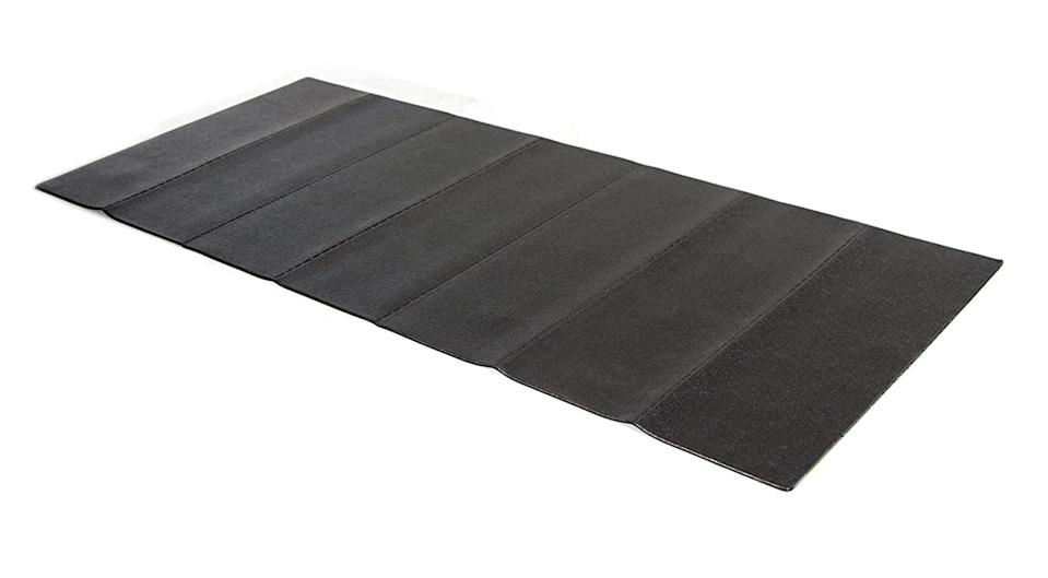 <p>If you have a Peloton Tread as well as a Peloton Bike, the <span>Stamina Fold-to-Fit Folding Equipment Mat</span> ($38, originaly $50) is an excellent choice. Divided into seven adjustable segments, the pebbled high-grip surface is designed to withstand the impact from both.</p>