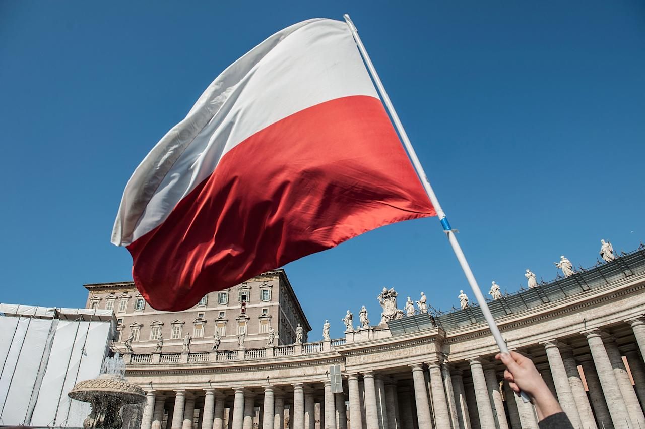 VATICAN CITY, VATICAN - FEBRUARY 17:  A faithful holds a Polish flag as he attends Pope Benedict XVI Angelus Blessing at St. Peter's Square on February 17, 2013 in Vatican City, Vatican. The Pontiff will hold his last weekly public audience on February 27 at St Peter's Square after announcing his resignation last week.  (Photo by Giorgio Cosulich/Getty Images)