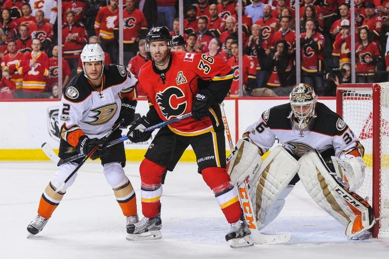 John Gibson (R) made 36 saves as the Ducks scored two goals early then held on for a 3-1 win to  eliminate the Flames from the Western Conference playoffs