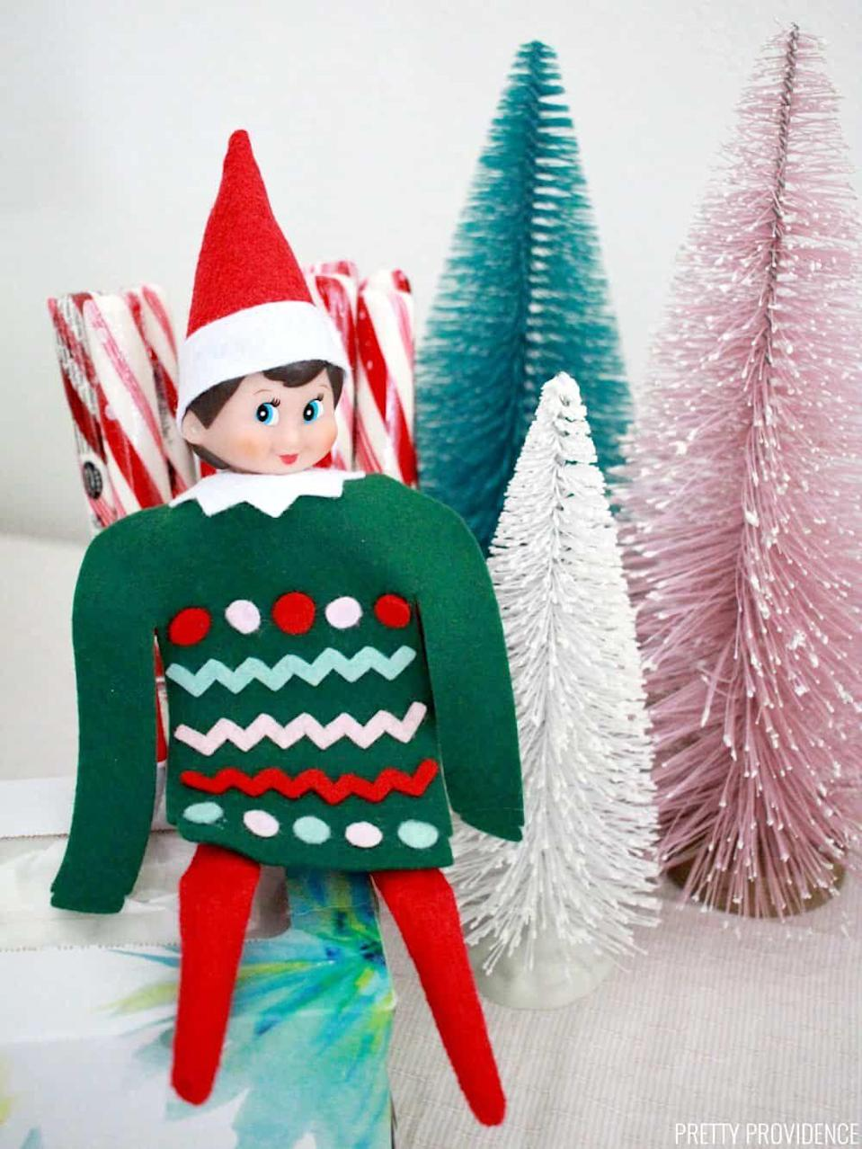 """<p>Everyone in your family will want to don their <a href=""""https://www.countryliving.com/shopping/g3915/christmas-sweaters/"""" rel=""""nofollow noopener"""" target=""""_blank"""" data-ylk=""""slk:ugly Christmas sweaters"""" class=""""link rapid-noclick-resp"""">ugly Christmas sweaters</a> after getting a peek of the Elf in his! It'll become a rite of passage.</p><p><strong>Get the tutorial at <a href=""""https://prettyprovidence.com/elf-on-the-shelf/"""" rel=""""nofollow noopener"""" target=""""_blank"""" data-ylk=""""slk:Pretty Providence"""" class=""""link rapid-noclick-resp"""">Pretty Providence</a>.</strong></p><p><strong><a class=""""link rapid-noclick-resp"""" href=""""https://www.amazon.com/42pcs-Fabric-Assorted-Squares-Nonwoven/dp/B01GCLS32M/?tag=syn-yahoo-20&ascsubtag=%5Bartid%7C10050.g.29656008%5Bsrc%7Cyahoo-us"""" rel=""""nofollow noopener"""" target=""""_blank"""" data-ylk=""""slk:SHOP FELT"""">SHOP FELT</a><br></strong></p>"""