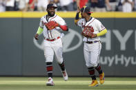 Atlanta Braves' Marcell Ozuna, left, celebrates with Ronald Acuna Jr. at the end of a baseball game against the Pittsburgh Pirates on Saturday, May 22, 2021, in Atlanta. The Braves won 6-1. (AP Photo/Ben Margot)