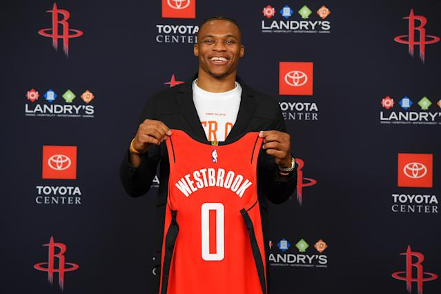 HOUSTON, TX - JULY 26: Russell Westbrook #0 of the Houston Rockets pose for a photo during the Houston Rockets Introductory Press Conference on July 26, 2019 at the Toyota Center in Houston, Texas. (Photo by Bill Baptist/NBAE via Getty Images)