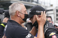 Marijn van Kalmthout talks with is son, Rinus VeeKay, of the Netherlands, during qualifications for the Indianapolis 500 auto race at Indianapolis Motor Speedway, Sunday, May 23, 2021, in Indianapolis. (AP Photo/Darron Cummings)
