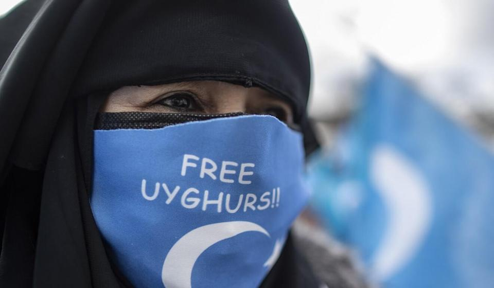 An Uygur woman during a protest against China near the Chinese consulate in Istanbul, Turkey on March 8. Photo: EPA-EFE