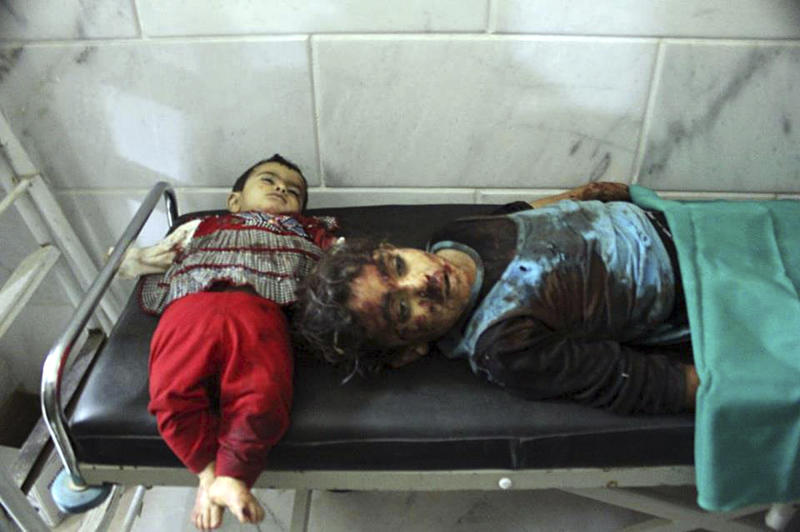 In this picture taken on Tuesday, Oct. 30, 2012, a citizen journalism image provided by Edlib News Network, ENN, which has been authenticated based on its contents and other AP reporting, the bodies of two young Syrian girls, who were killed by the shelling by Syrian forces loyal to Syrian President Bashar Assad, lie on a hospital bed at Kfar Batikh village, in Idlib province, northern Syria. Syrian warplanes fired missiles at opposition strongholds around Damascus and in the north on Wednesday as Turkey, a key backer of the anti-regime rebels, appeared to distance itself from an earlier call to impose a no-fly zone. (AP Photo/Idlib News Network ENN)